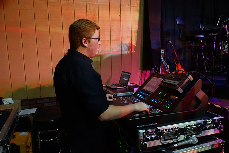 Colten Hyten at stage right, working with the Roland M-5000C Live Mixing Console.