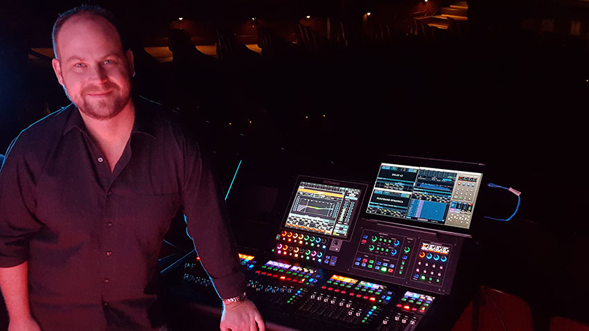 Michael Gaster, pictured with the Roland M-5000 OHRCA Live Mixing Console. Photo courtesy of Michael Gaster. © 2015.