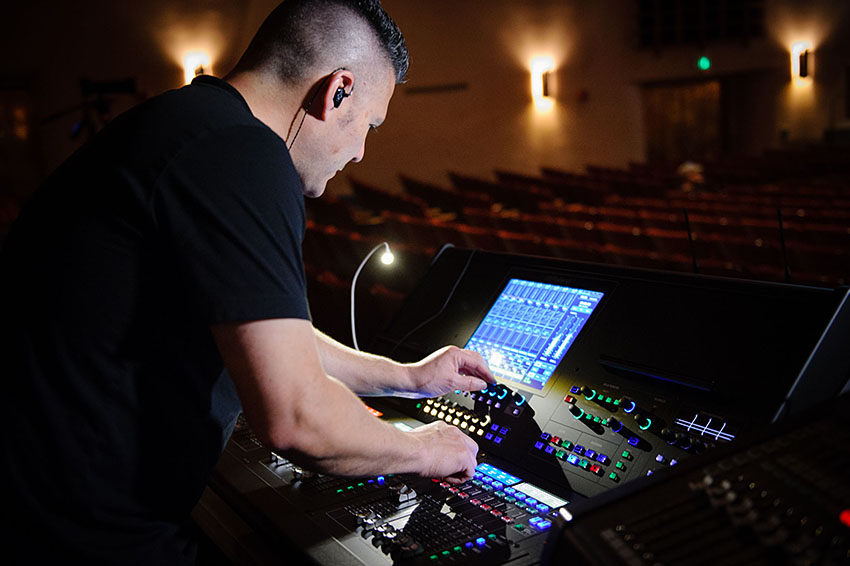 Vocalosity Technical Director and Front-of-House Engineer Tony Huerta, pictured with the Roland M-5000 OHRCA Live Mixing Console.