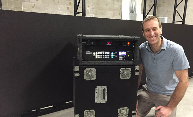 Daniel Willis of AV Technik, pictured with the Roland XS-83H 8-In x 3-Out Multi-Format AV Matrix Switcher.